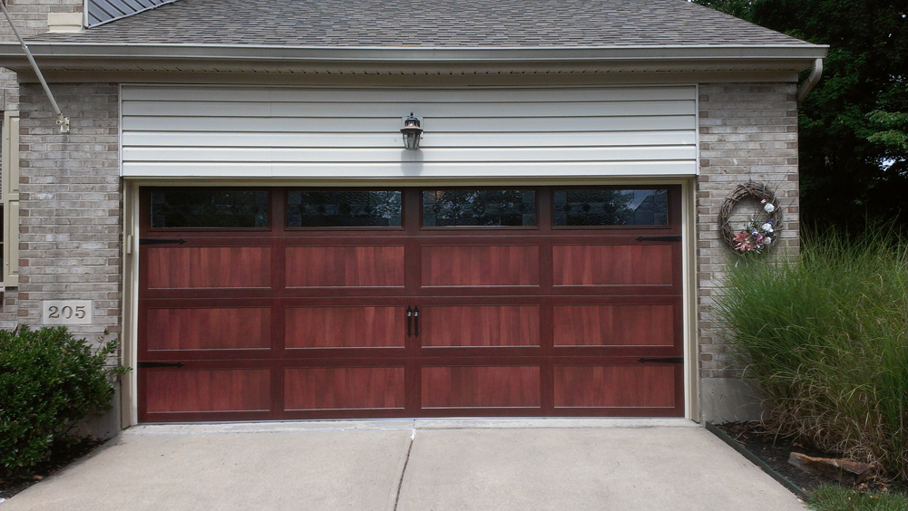 Stamped steel long panel carriage house door in cincinnati for Murphy garage doors